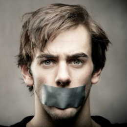 Image of a man with duct tape over his mouth